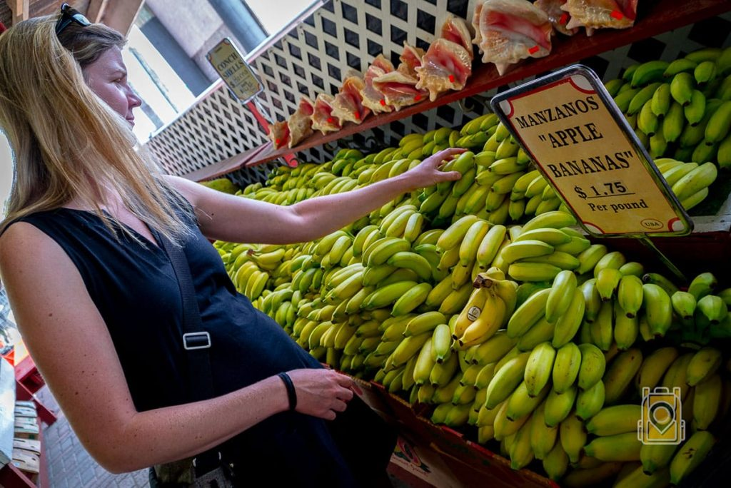 Tiffany picking out some apple bananas at Robert Is Here fruit stand in south Florida