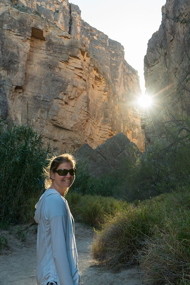 things to do big bend national park: a view of a hiker in santa elena canyon